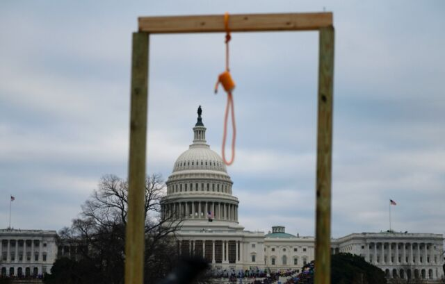A noose hung from a makeshift gallows as supporters of outgoing President Donald Trump gathered on the west side of the US Capitol in Washington DC on January 6, 2021.