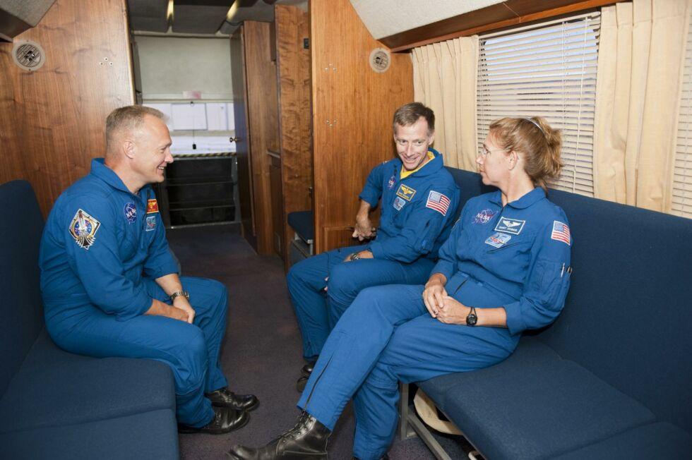 NASA astronauts Doug Hurley, Chris Ferguson, and Sandy Magnus inside the Astrovan in 2011.