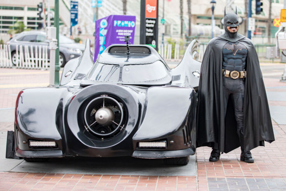 This guy isn't actually Batman, either, but he's a lot closer to being Batman than we are. (This is cosplayer Auri Aminpour next to his Batmobile. Wicked!)